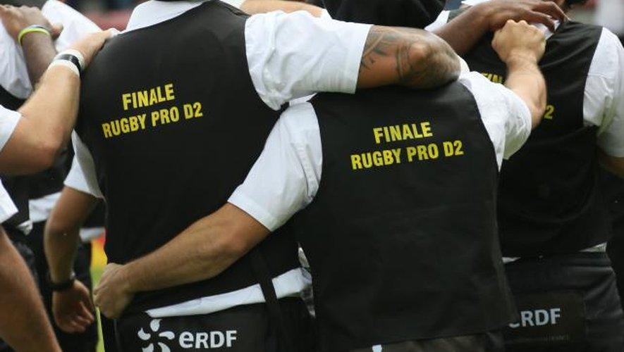 """<p class=""""txt-legende-2011""""><B>Les Montois peuvent nourrir des regrets après cette défaite en finale d'accession face à Agen. </B>Photos Midi Olympique - Patrick Derewiany</p>"""