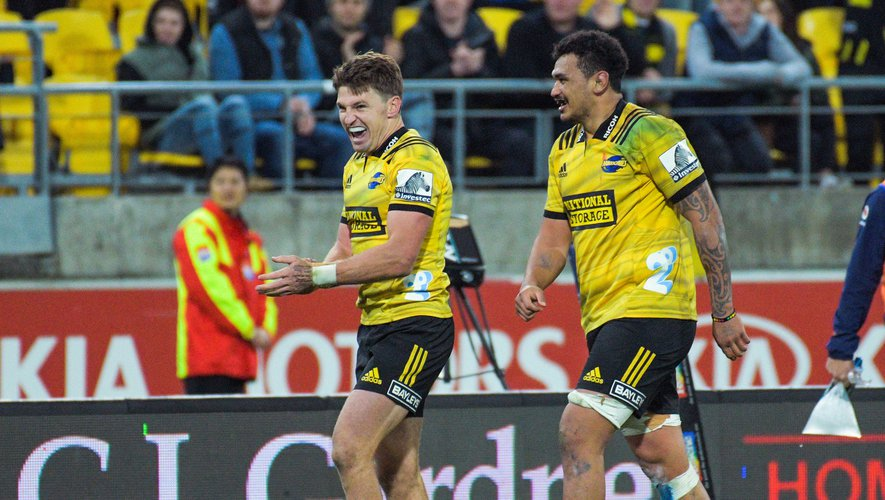Hurricanes' Beauden Barrett (left) and Hurricanes' Isaia Walker-Leawere react at the final whistle of the Super Rugby quarterfinal between the Hurricanes and Bulls at Westpac Stadium in Wellington, New Zealand on Saturday, 22 June 2019. Photo: Dave Lintott / Icon Sport